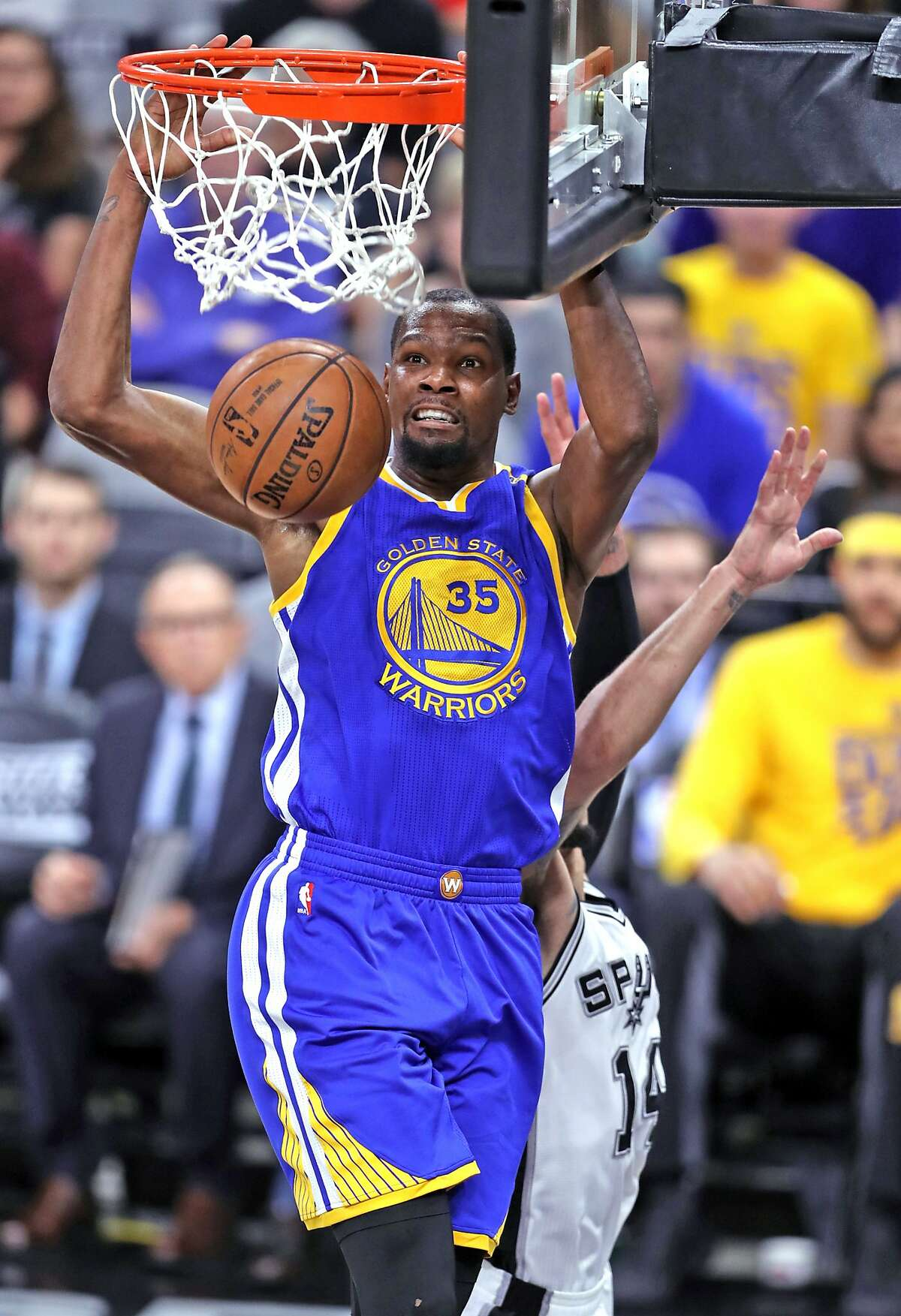 Golden State Warriors' Kevin Durant dunks against San Antonio Spurs' Danny Green in 1st quarter during Game 4 of NBA Western Conference Finals at AT&T Center in San Antonio, Texas, on Monday, May 22, 2017.