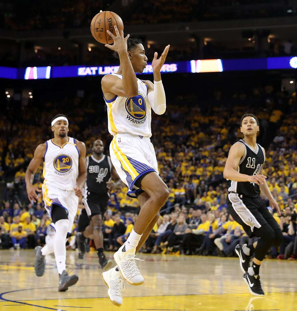 Golden State Warriors' Patrick McCaw makes a pass to James Michael McAdoo during Warriors' 136-100 win over San Antonio Spurs in Game 2 of NBA Western Conference Finals in Oakland, Calif., on Tuesday, May 16, 2017.