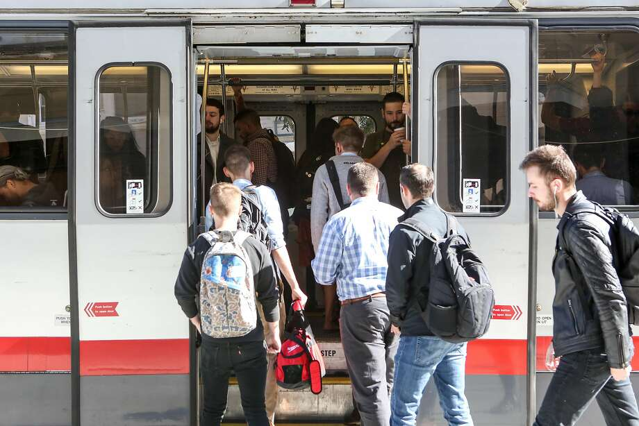 Riders get onto an already crowded N Judah Muni train during the morning commute on Thursday, June 15, 2017 in San Francisco. Photo: Amy Osborne, Special To The Chronicle