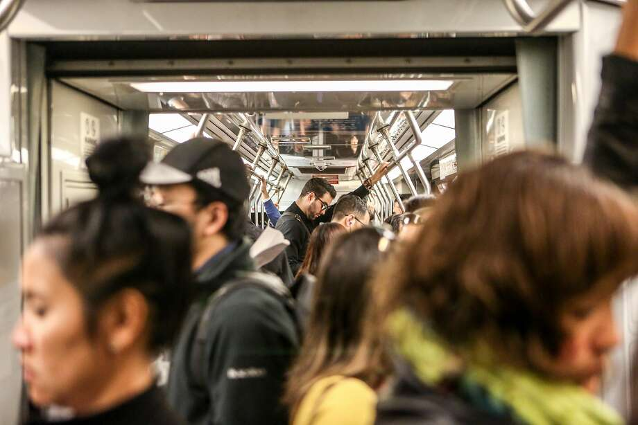 Riders crowd the N-Judah train during the morning commute. Photo: Amy Osborne, Special To The Chronicle