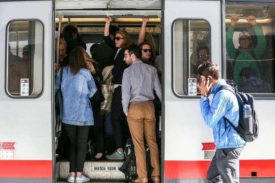 Riders squeeze onto the N Judah Muni train during the morning commute on Thursday, June 15, 2017 in San Francisco, Calif. Wednesday morning at around 8:30am, a passenger on the N-Judah streetcar pulled a knife and threatened other passengers during the rush-hour commute. Photo: Amy Osborne, Special To The Chronicle