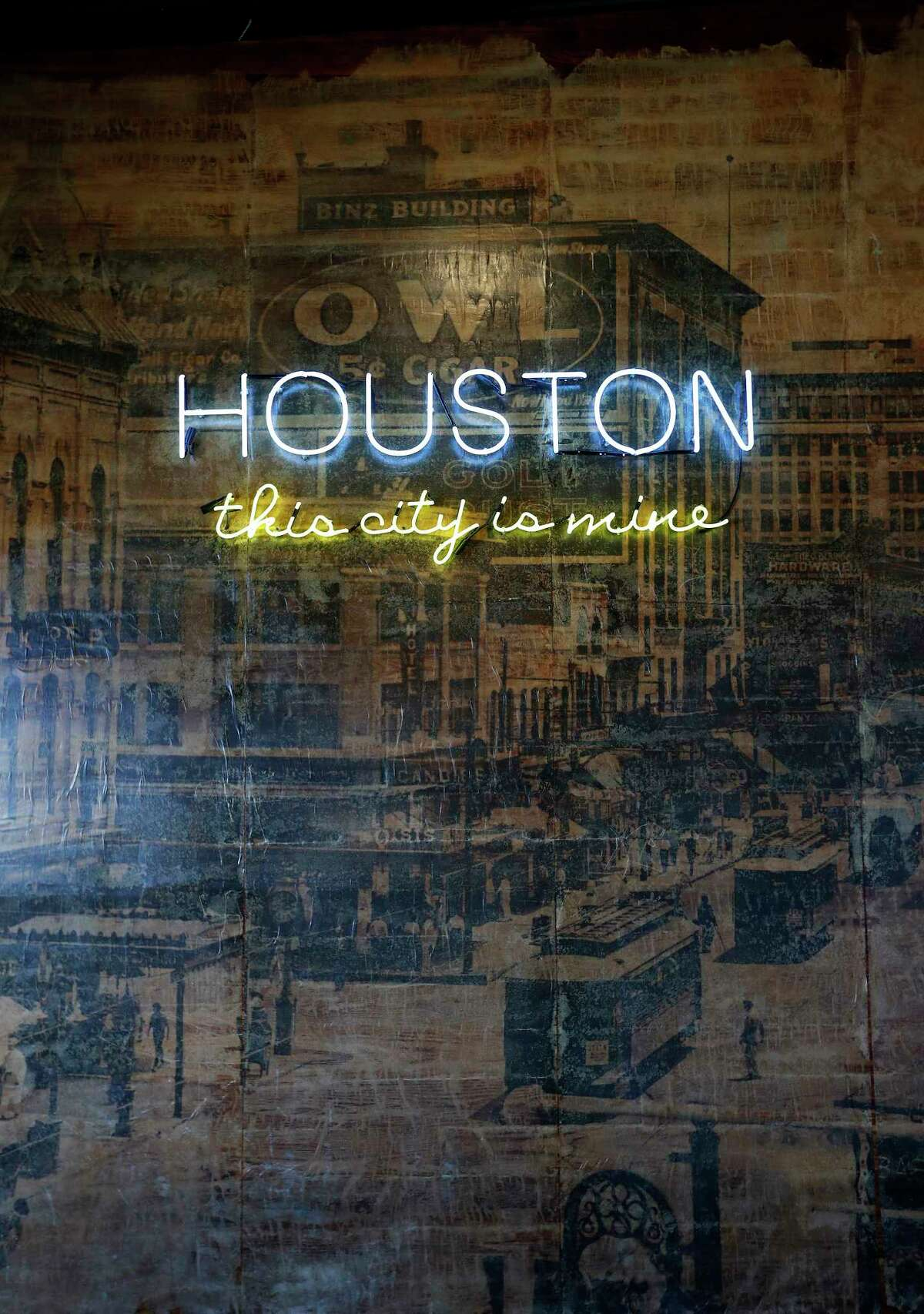 Detail of neon on top of a photo of downtown Houston at Chapman & Kirby, 2118 Lamar.