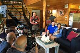 Jon Meier and Kristen Flowers are filmed with their newborn for footage in a new DIY/HGTV reality show about Houston business, Backcountry Containers.