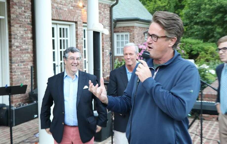 "New Canaan First Selectman Rob Mallozzi III and Selectman Nick Williams with ""Morning Joe with Mika Brzezinski"" host Joe Scarborough at their re-election campaign on June 2. Photo: Contributed"