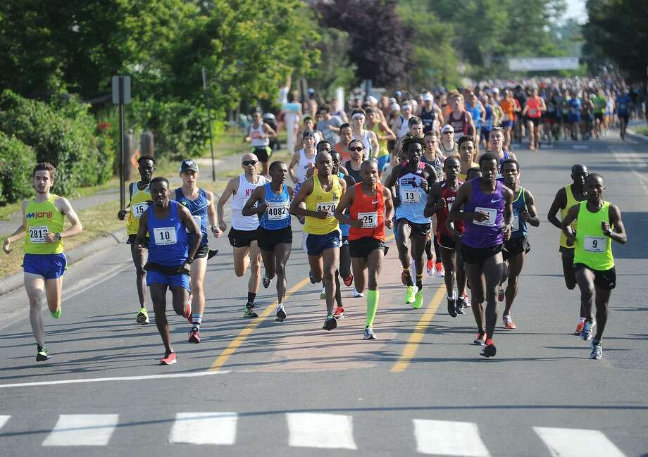 The start of the 2016 Faxon Law Fairfield Half Marathon on Fairfield Beach Road in Fairfield, Conn. on Sunday, June 25, 2016. Photo: Brian A. Pounds / Hearst Connecticut Media / Connecticut Post