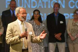 Curtis O. Law, executive director of the Norwalk Housing Authority, says a few words to the crowd during last year's Annual Scholarship Awards Ceremony at Stepping Stones Museum for Children.