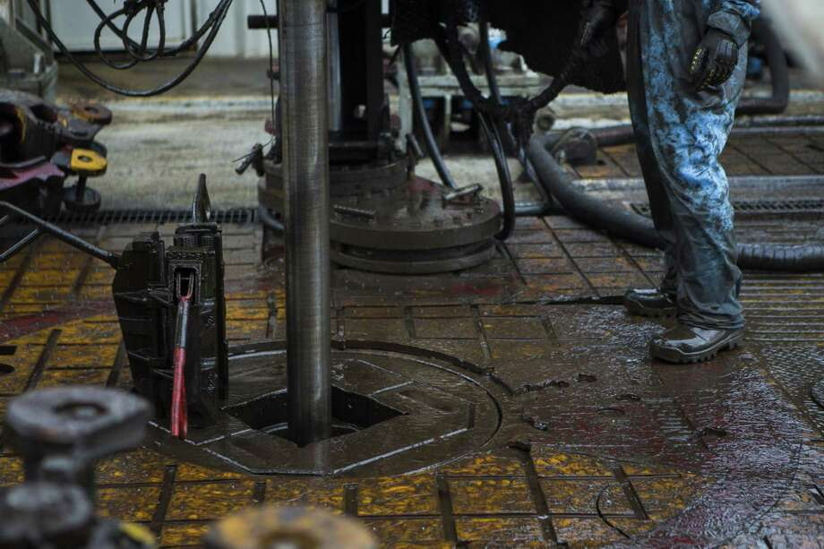 Oil workers drill for oil on a rig near College Station in May. On Friday, the Texas Workforce Commission reported energy drilling jobs had the most job growth, adding 6,000 jobs during May. Photo: Marie D. De Jesus /Houston Chronicle / Internal