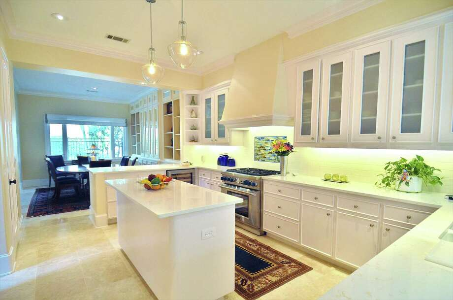 This kitchen remodel includes plenty of storage and good workflow. Photo: Courtesy Of Legal Eagle Contractors