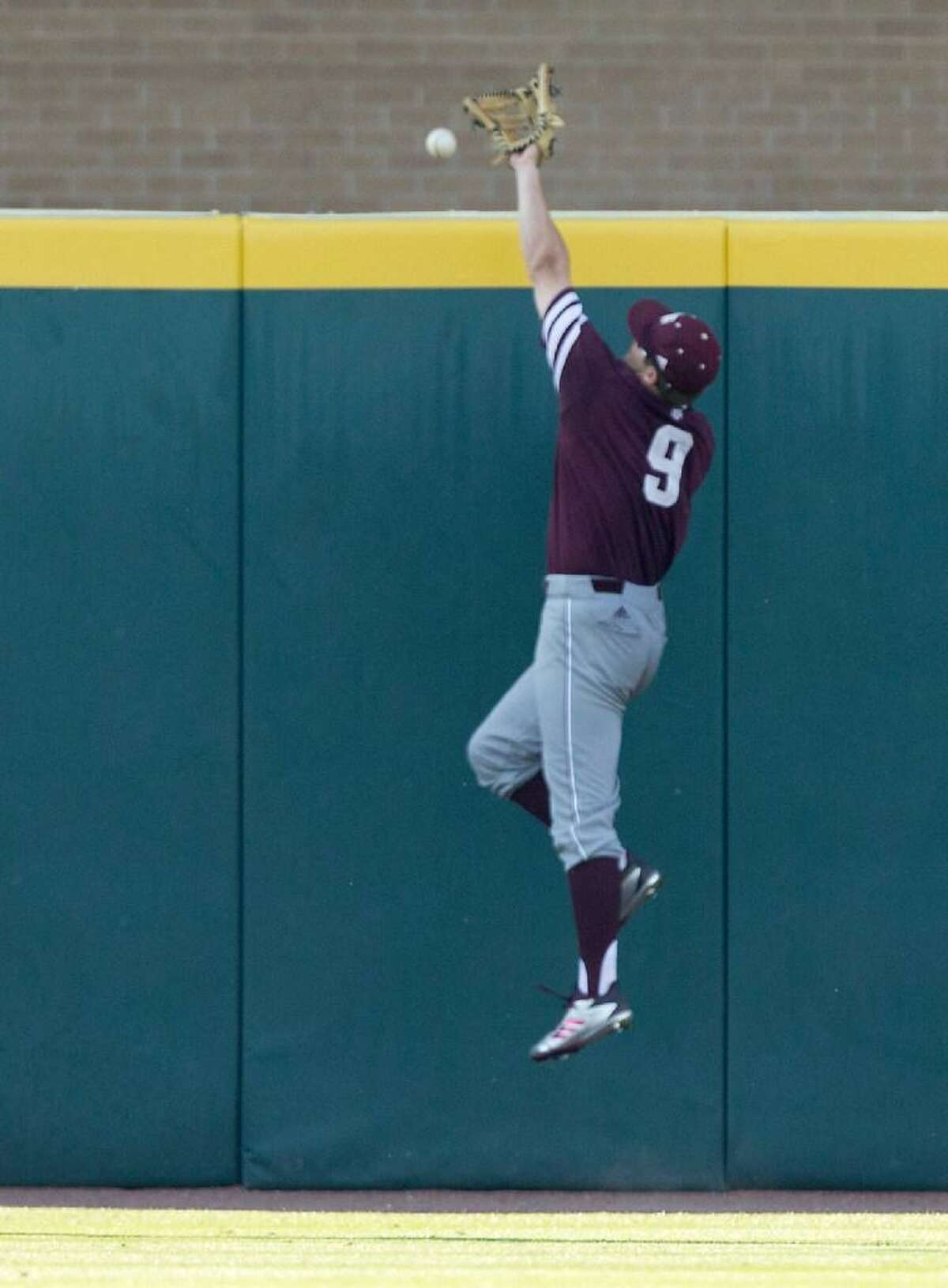 Texas A&M outfielder Walker Pennington (9) misses a ball hit by Davidson outfielder Cam Johnson (10) during the fifth inning of an NCAA college baseball tournament super regional game Saturday, June 10, 2017, in College Station, Texas.