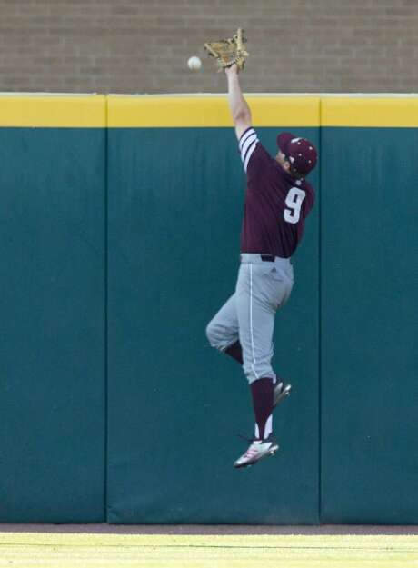 Texas A&M outfielder Walker Pennington (9) misses a ball hit by Davidson outfielder Cam Johnson (10) during the fifth inning of an NCAA college baseball tournament super regional game Saturday, June 10, 2017, in College Station, Texas. Photo: Sam Craft /AP Photo