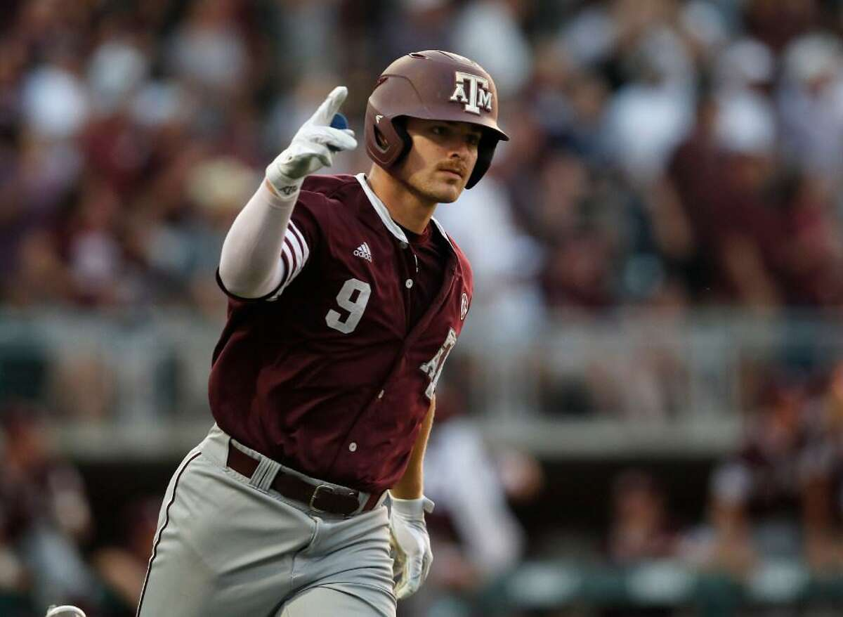 Texas A&M outfielder Walker Pennington (9) celebrates while running to first after a home run in the ninth inning during the 2017 NCAA Super Regional baseball game between the Davidson Wildcats and the Texas A&M Aggies at Blue Bell Park on Saturday, June 10, 2017, in College Station, TX.