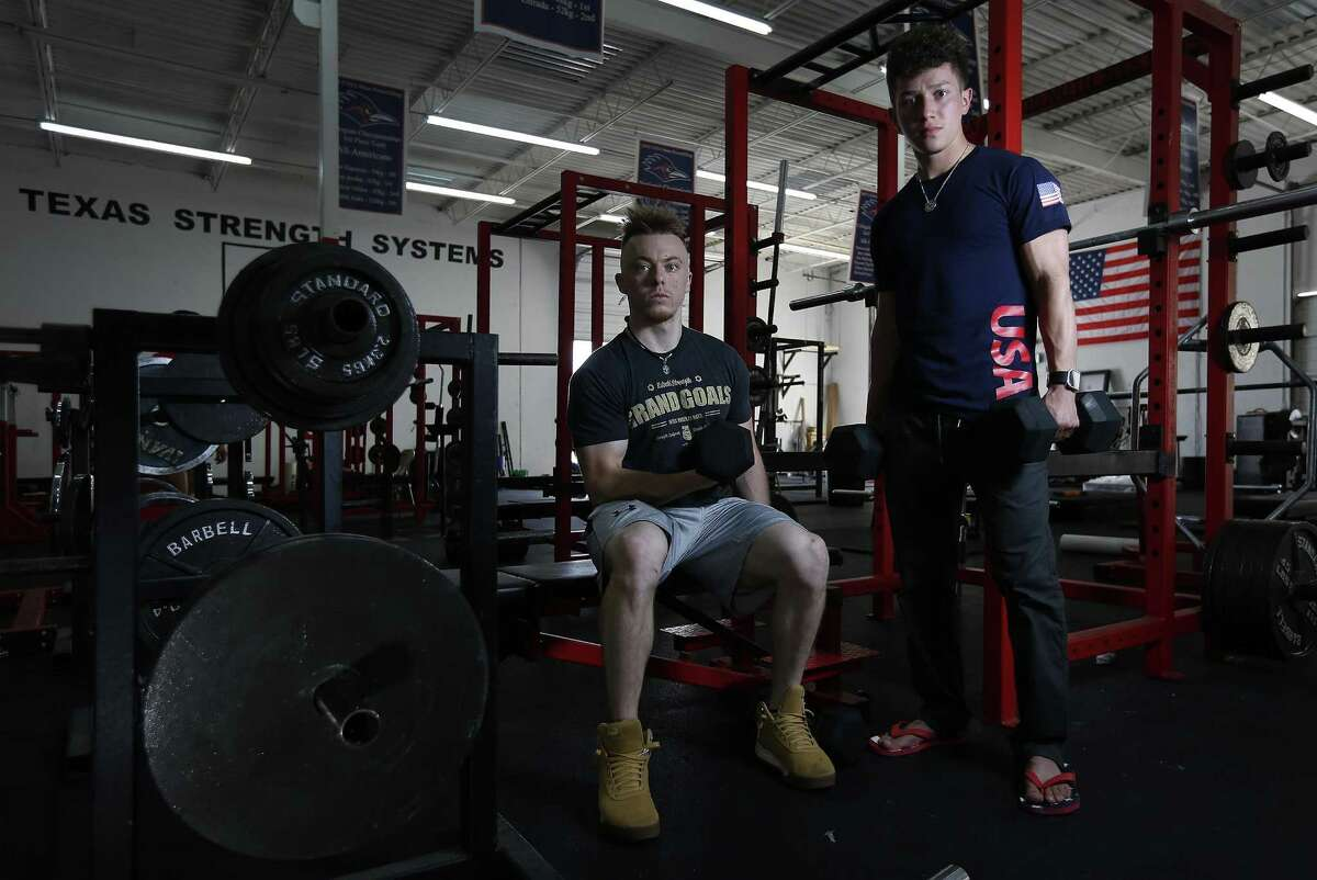 Area powerlifters Jorge Saldana (right) and Sawyer Yandell are heading to the IPF World Open Classic Powerlifting Championships in Minsk, Belarus as part of Team USA. Saldana and Yandell befriended one another in high school where both began their formal training into weightlifting. (Kin Man Hui/San Antonio Express-News)