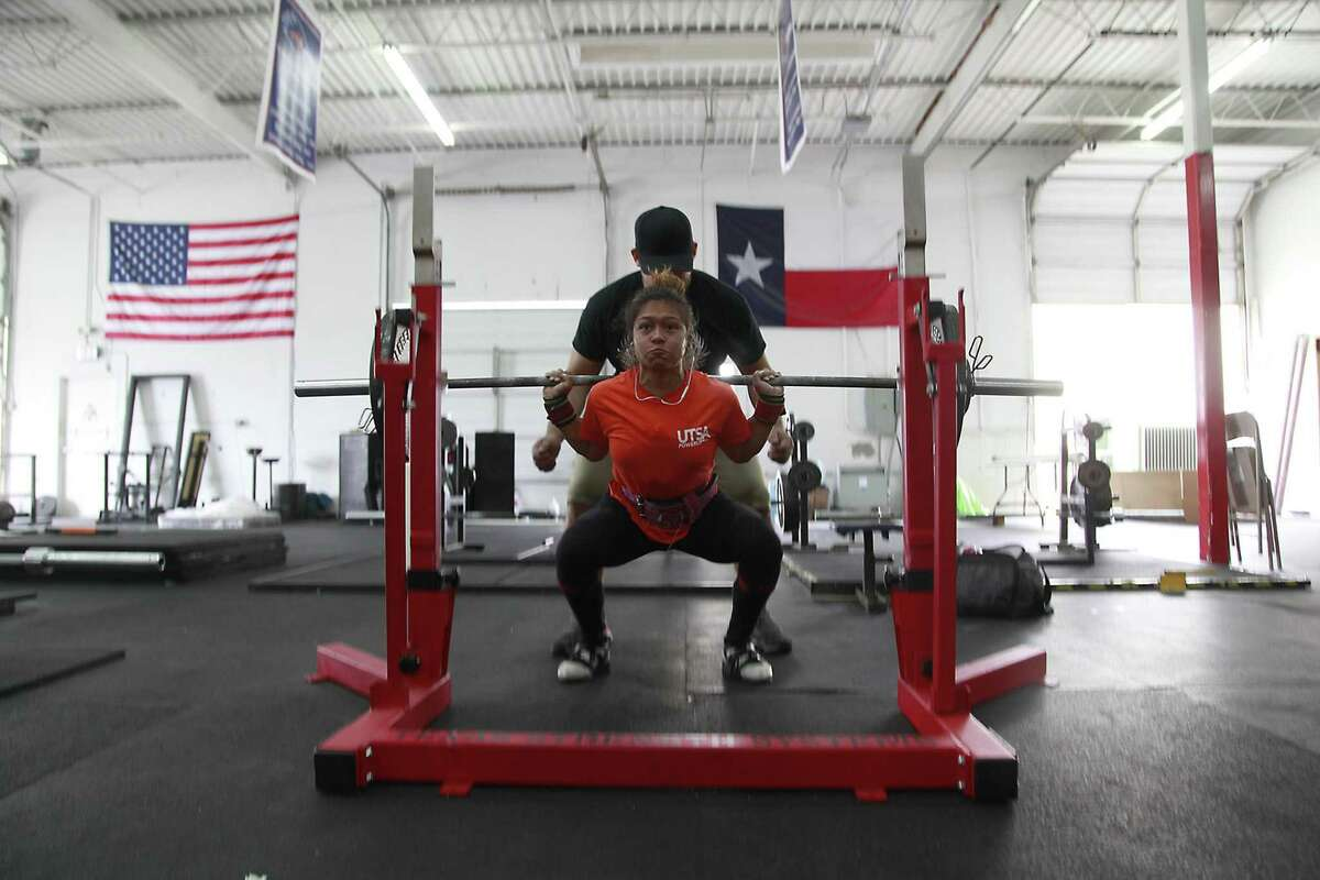 """Victoria Vargas, a champion powerlifter at the University of Texas at San Antonio, works out at Texas Strength Systems Gym before heading off to classes. The Moore native won gold at the USA Powerlifting Collegiate National Championships this year. She also won gold in last year's competition.""""I love powerlifting,"""" said Vargas, 22."""