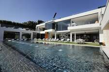 This Thursday, Jan. 26, 2017 photo shows an 85-foot infinity swimming pool at a $250 million mansion in the Bel-Air area of Los Angeles. At $250 million, the new mansion in the exclusive Bel-Air neighborhood of Los Angeles is the most expensive home listed in the U.S. (AP Photo/Jae C. Hong)