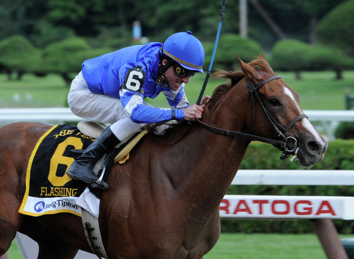 Flashing with jockey Richard Migliore in the irons wins the 84th running of the Test Stakes at the Saratoga Race Course August 8, 2009. (Skip Dickstein / Times Union)