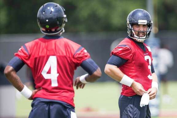 For now, Tom Savage, right, is the Texans' starting QB, but plenty of eyes will be on first-round pick Deshaun Watson, left, in camp.