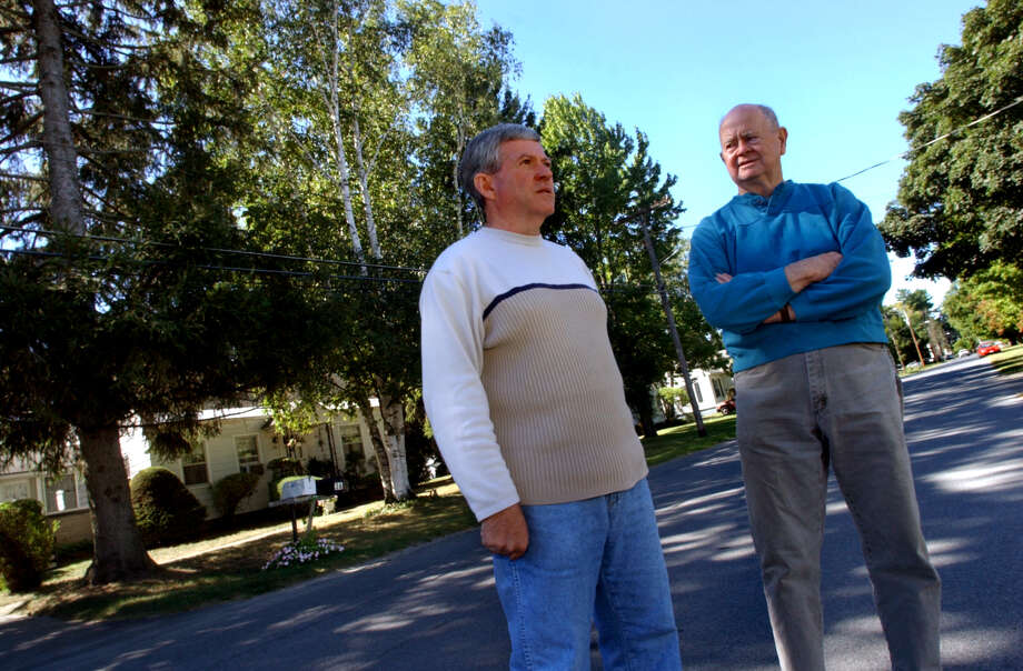 Dennis Prevost, left, talks with former neighbor Paul Cronin, right, about the high number of cancer victims in his former neighborhood Thusday, Sept. 12, 2002, in Fort Edward, N.Y. Prevost told the Times Union in June 2017 that it was frustrating that the state Health Department said up front they would not make any links between PCB use in Fort Edward and any cancer elevations found.  (Cindy Schultz/Times Union) Photo: CINDY SCHULTZ / ALBANY TIMES UNION