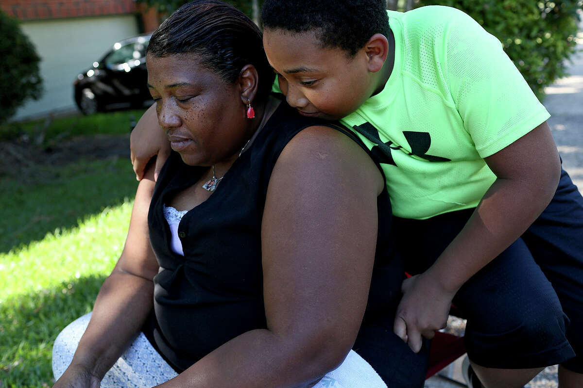 Xavier Turner, 12, and his mother, sit outside their home on Sunday, June 11, 2017.