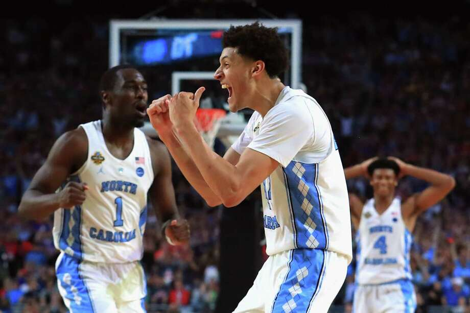 Small forward Justin Jackson, center, returned for his junior year and helped North Carolina  capture a national championship in April. Photo: Tom Pennington, Staff / Stratford Booster Club