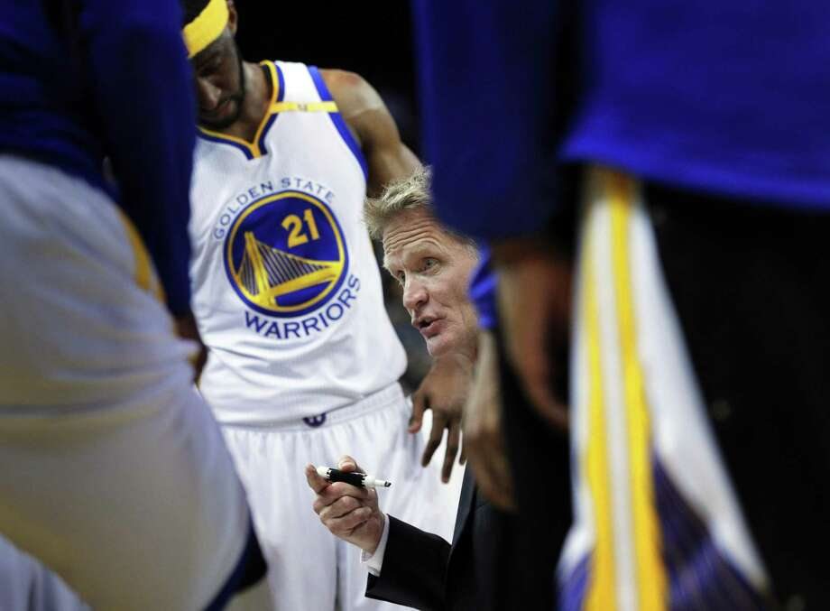 Head coach Steve Kerr draws out a play for his players during a timeout in the the fourth quarter as the Golden State Warriors played the Minnesota Timberwolves at Oracle Arena in Oakland, Calif., on Tuesday, April 4, 2017. Photo: Carlos Avila Gonzalez / The Chronicle / ONLINE_YES