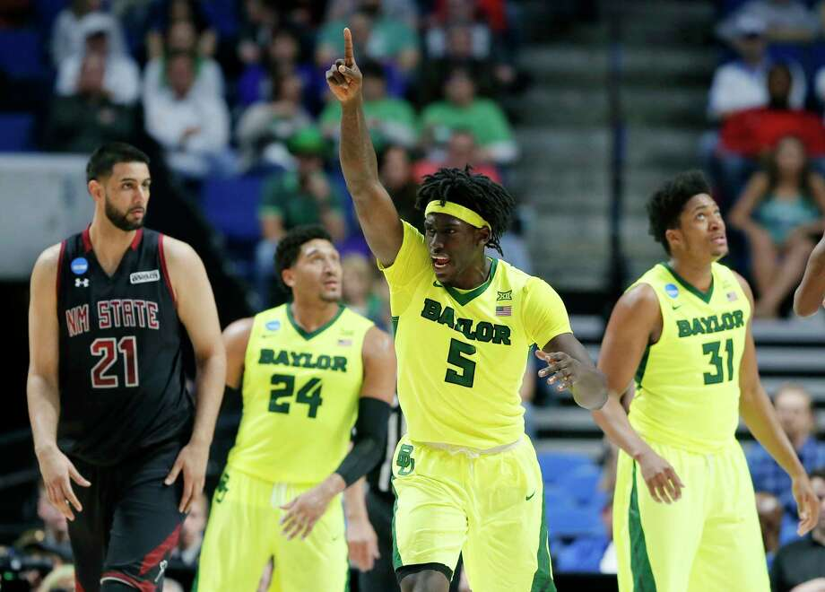 Forward Johnathan Motley, center, averaged 17.3 points during his final season at Baylor, putting himself on the radars of several NBA scouts leading up to the draft. Photo: Tony Gutierrez, STF / Copyright 2017 The Associated Press. All rights reserved.