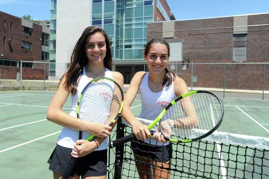 Stamford High freshman Devon, left, and Taylor Yaghmaie pose for a photo on the tennis courts behind Stamford High School in Stamford, Conn. on Wednesday, June 14, 2017. The twins won the CIAC girls doubles championship last week at Yale to cap off an impressive season. Photo: Michael Cummo / Hearst Connecticut Media / Stamford Advocate