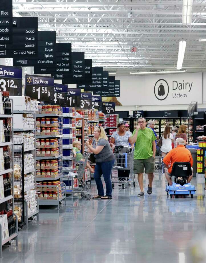 Shoppers Work Their Way Through The Aisles Of Grocery Section In Newly Opened Wal