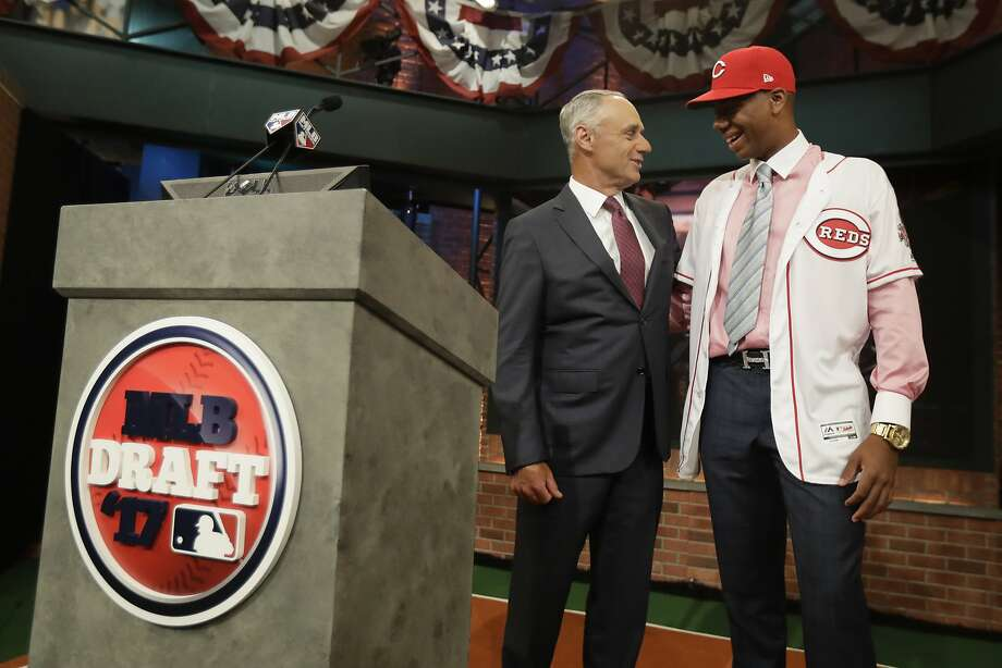Hunter Greene, right, a pitcher and shortstop from Notre Dame High School in Sherman Oaks, Calif., talks to commissioner Rob Manfred after being selected No. 2 by the Cincinnati Reds in the first round of the Major League Baseball draft, Monday, June 12, 2017, in Secaucus, N.J.(AP Photo/Julio Cortez) Photo: Julio Cortez, Associated Press