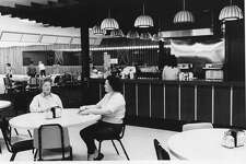 Snack bar facilities are available to bowlers. In the background is the Golden Cue, with pool tables available for casual or league play. April 1966
