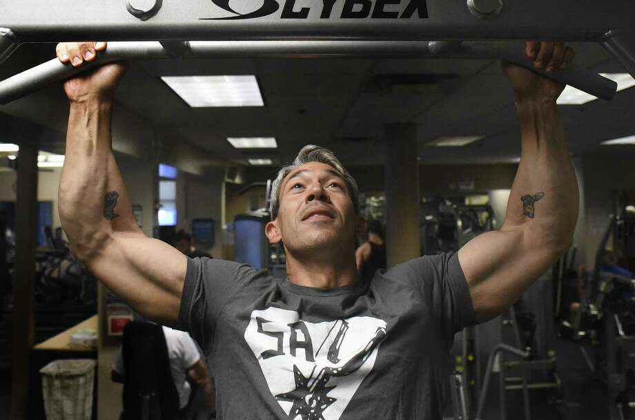 Strength training helps keep him sharp both mentally and physically, said mayor-elect Ron Nirenberg, shown doing pull downs at the Barshop Jewish Community Center fitness center. Photo: Billy Calzada /San Antonio Express-News / San Antonio Express-News