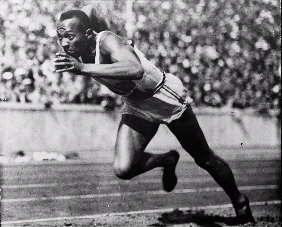 Jesse Owens  is shown in a 200-meter preliminary heat at the 1936 Summer Olympics in Berlin. Photo: ST