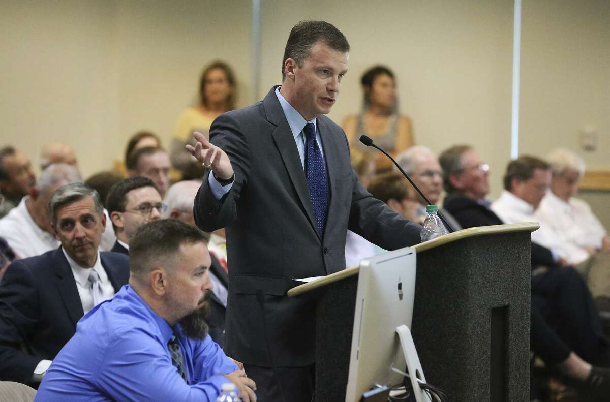 Trey Jacobson, representative of the Tobin Endowment, presents plans as residents of the Oakwell Farms neighborhood appear before the Planning Commission to express their objections to a proposed apartment dwelling development within their area on June 10, 2015.