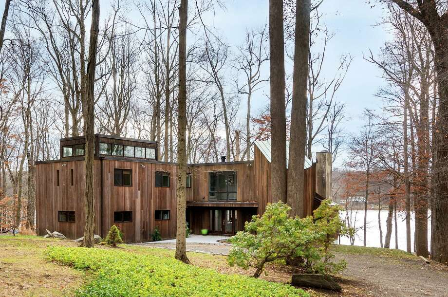 This contemporary house, with windows on all four sides, offers views of eagles soaring over Taunton Lake, and will be among the properties featured in The Newtown Historical Society House & Garden Tour, set for Sunday, June 25. Photo: Daniel Milstein / Contributed Photo