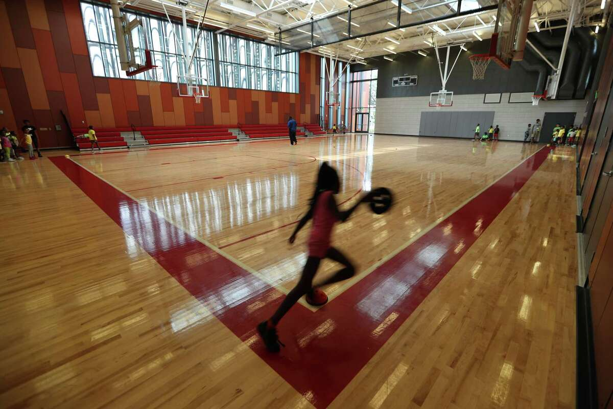 A girl plays inside the new Emancipation Park gym, part of a $34 million redevelopment project.