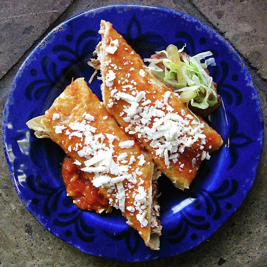 A rolled taco entomatado with chicken in a handmade tortilla from La Siberia Taquería. Photo: Mike Sutter /San Antonio Express-News