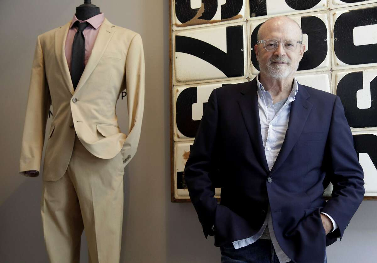 """FILE- This Aug. 8, 2012, file photo J. Crew CEO Millard """"Mickey"""" Drexler poses for a picture at a J. Crew store in New York. James Brett, the president of home decor chain West Elm, will take over as chief executive of J. Crew in July. Drexler, the retail veteran who helped take the company private in 2011, will remain J.Crew's chairman. (AP Photo/Seth Wenig)"""