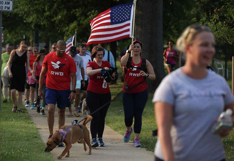 A group of veterans participate in a run/walk event to show solidarity after a shooting at the Eugene Simpson Stadium Park Thursday in Alexandria, Virginia. U.S. House Majority Whip Rep. Steve Scalise (R-LA) and multiple congressional aides were shot by a gunman during a Republican baseball practice. Photo: Alex Wong /Getty Images / 2017 Getty Images