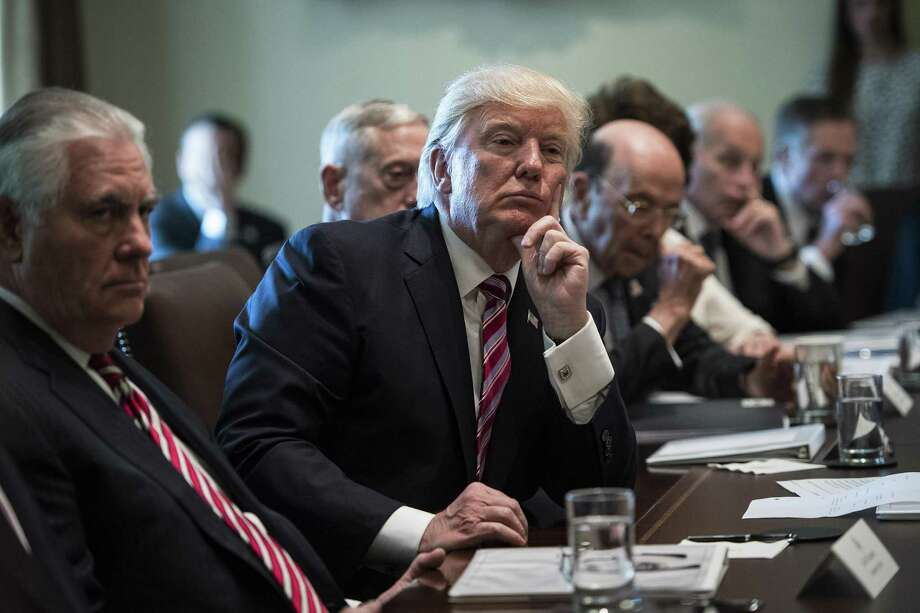 President Donald Trump listens during a Cabinet meeting in the White House on Monday. What is the president teaching our youth about civics? Photo: Jabin Botsford /The Washington Post / The Washington Post