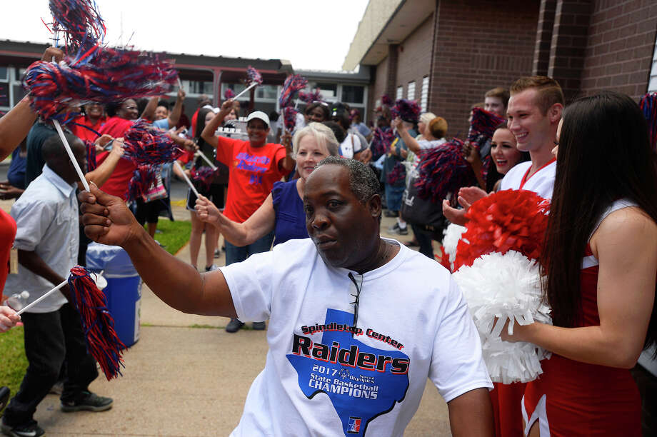 Kenneth Smith, a chaperone for the Spindletop Raiders, dances to celebrate the basketball team's Special Olympics championship at Spindletop Center on Friday. The team won the Special Olympics state basketball tournament in Arlington May 25 through 28, winning three games to become state champions.  Photo taken Friday 6/16/17 Ryan Pelham/The Enterprise Photo: Ryan Pelham / ©2017 The Beaumont Enterprise/Ryan Pelham