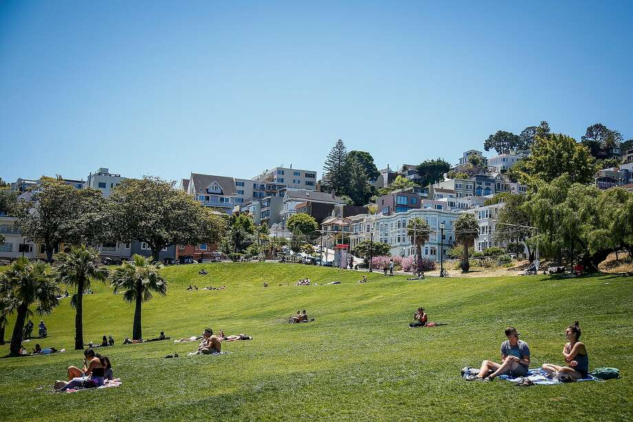 People sunbathe in Mission Dolores Park on a sunny day in San Francisco. Click through the gallery for pictures of people enjoying the unusually warm and dry February. Photo: Nicole Boliaux, The Chronicle