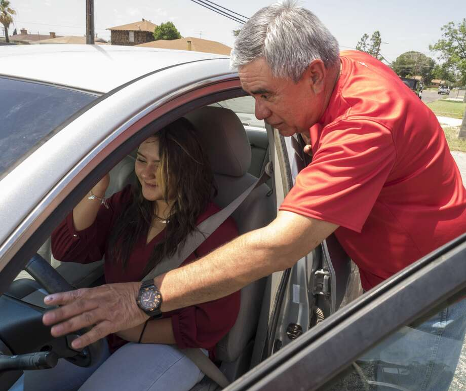 Abel Abundez, Big C Driver Education instructor, goes over driver controls 6/15/17 with Brianna Martinez in one of the driver ed cars. Tim Fischer/Reporter-Telegram Photo: Tim Fischer/Midland Reporter-Telegram