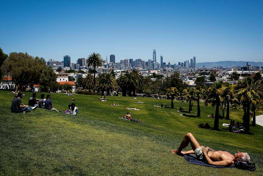 People sunbathe in Mission Dolores Park in San Francisco on June 13, 2017. Photo: Nicole Boliaux, The Chronicle