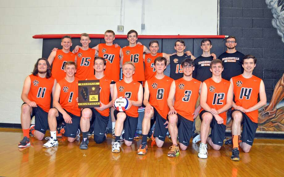 The EHS boys' volleyball team poses with the Granite City Regional championship plaque after defeating Belleville West in the finals.