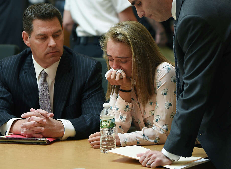 Michelle Carter cries while flanked by defense attorneys Joseph Cataldo, left, and Cory Madera, after being found guilty of involuntary manslaughter in the suicide of Conrad Roy III, Friday, June 16, 2017, in Bristol Juvenile Court in Taunton, Mass. (Glenn C.Silva/Fairhaven Neighborhood News, Pool) Photo: Glenn C. Silva, POOL / Copyright Glenn C.Silva/Fairhaven Neighborhood News.