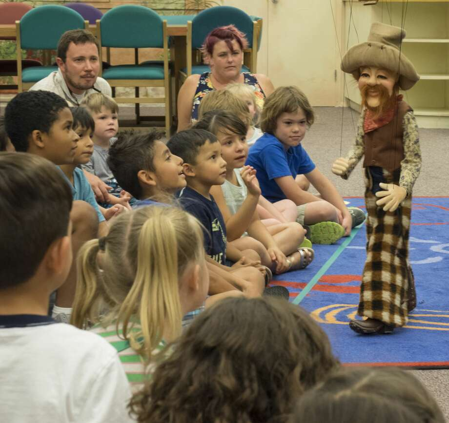 Kent Williams, with Geppetto's Marionette Theater out of Dallas, performs 6/15/17 at the Midland County Library downtown branch. Tim Fischer/Reporter-Telegram Photo: Tim Fischer/Midland Reporter-Telegram