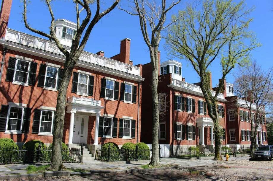The Three Bricks (1837-40), homes built on Main Street by Nantucket entrepreneur Joseph Starbuck, are considered architectural treasures. Photo: Alan Solomon, MBR / Chicago Tribune