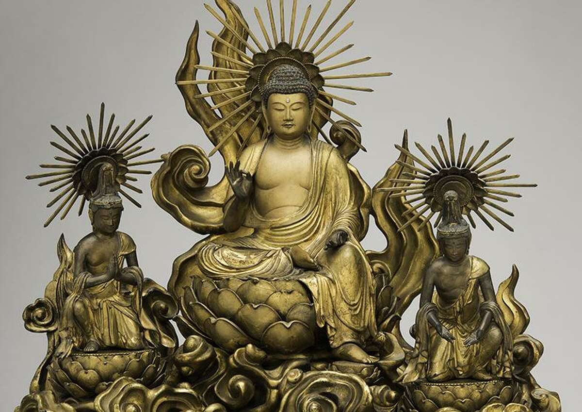 """""""Amida Buddha with Attending Bodhisattvas"""" is a late 18th century wood sculpture adorned with gold, pigment and metal. It is one of the works in """"Heaven & Hell: Salvation and Retribution in Pure Land Buddhism,"""" an exhibit at the San Antonio Museum of Art."""