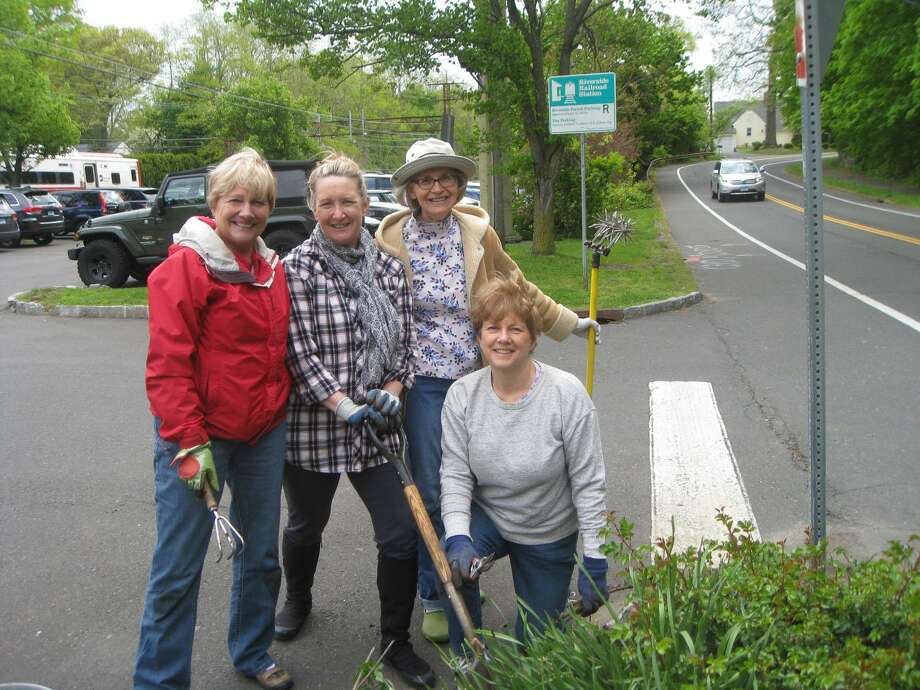 From left, Jane Harris, club president Gaby Crouchley, Susan Foster with Linda Porter of the Riverside Garden Club are taking time out from their spring planting and sprucing up at the south garden of the Riverside Railroad Station Photo: Contributed