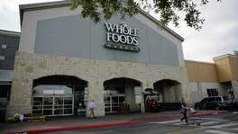 Whole Foods Market shareholders agreed Wednesday to sell the Austin grocery chain to Amazon for $13.7 billion.