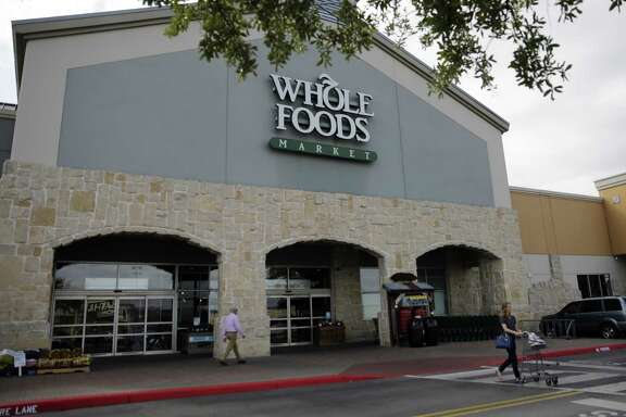 Sales at Whole Foods Market grocery stores rose to $3.7 billion in the third quarter but same-store sales fell for the eighth straight quarter, the company said Wednesday.